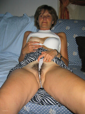 Mature lady friend revealing her moist hairy vagina online