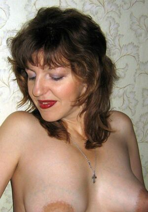 This fifty-year lady sucking small dick. Her red lips tightly compressed prick. Amateur, homemade images of a mature couple, POV.