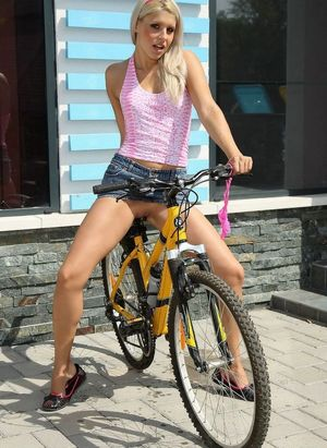 Playful cutie wear no panties. She even ride bicycle sitting by nude pussy on bicycle seat.