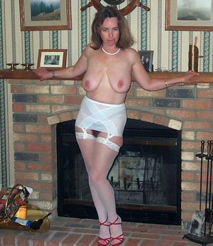 Busty MILF in white lingeries posing for her husband